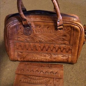 Genuine leather handbag with matching wallet.
